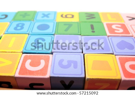 children toy letter building blocks against a white background - stock photo