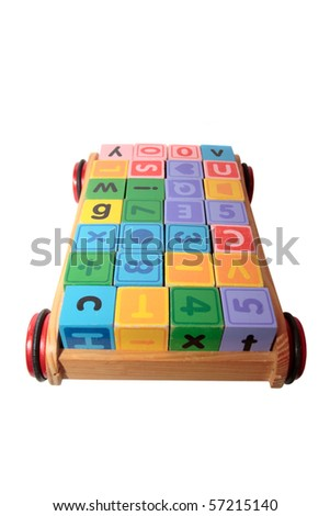 children toy letter building blocks all together in a toy cart isolated on white background