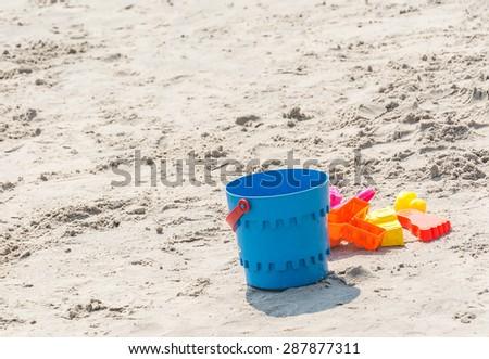 children toy on the beach - stock photo