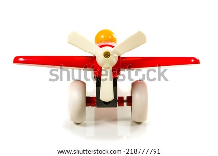 Children toy wooden airplane propeller positioned forward isolated on white background - stock photo