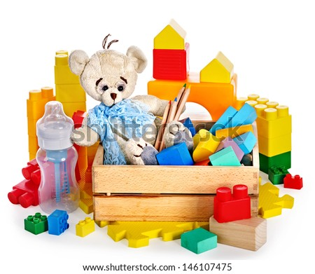 Children toys with teddy bear and cubes. Isolated. - stock photo