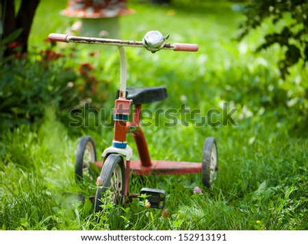 Children tricycle bicycle  - stock photo