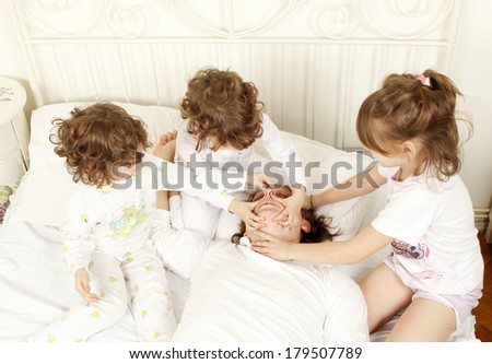 Children trying to stop her father to snore - stock photo