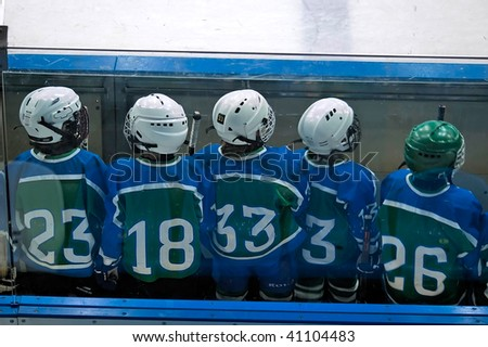 Children waiting of time to play hockey - stock photo