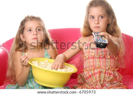 children watching a movie eating popcorn - stock photo