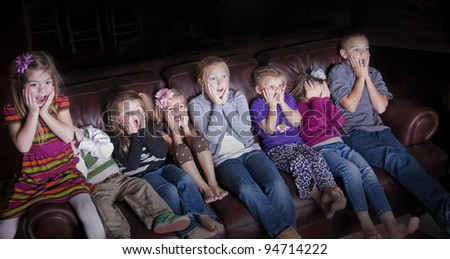 Children watching Shocking Television Programming - stock photo
