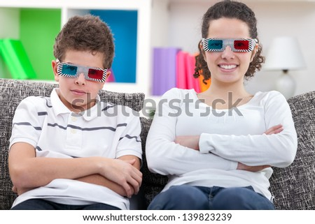 children watching  the 3D movie at home - stock photo