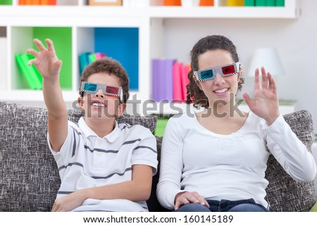 children watching TV with 3D glasses at home  - stock photo