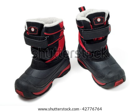 Children waterproof winter boots isolated on white - stock photo
