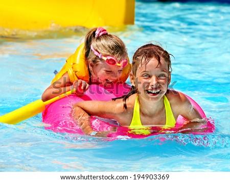 Children wearing life jacket in swimming pool. - stock photo