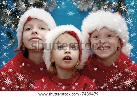 Children wearing Santa Claus hats and snowflake frame - stock photo