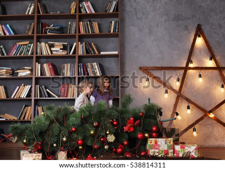Children were afraid that the tree has been dropped. Christmas concept
