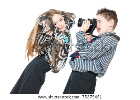 children with a camera isolated on white - stock photo