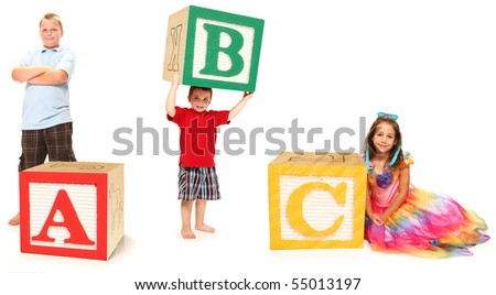 Children with ABC spelled out in colorful alphabet blocks over white. - stock photo