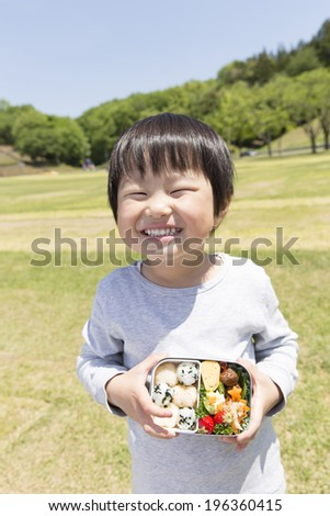 Children with and happily lunches mother hand view chestnut - stock photo