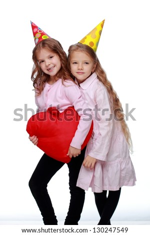 Children with beautiful and healthy hair, having fun and dancing in the spring festival on white background