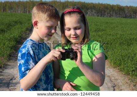 children with camera - stock photo