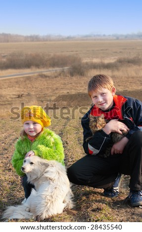 children with cat and dog - stock photo