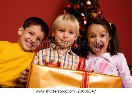 Children with christmas gift - stock photo