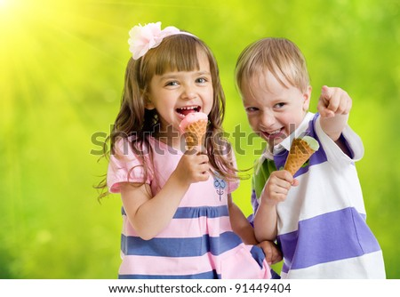 Children with icecream cone outdoor in hot summer day - stock photo