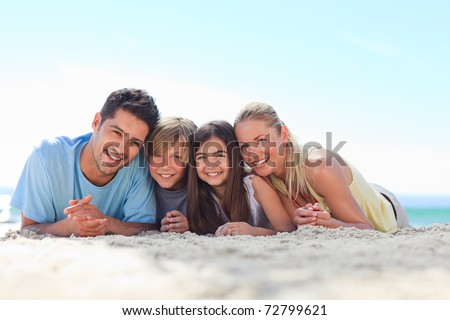 Children with their parents at the beach - stock photo