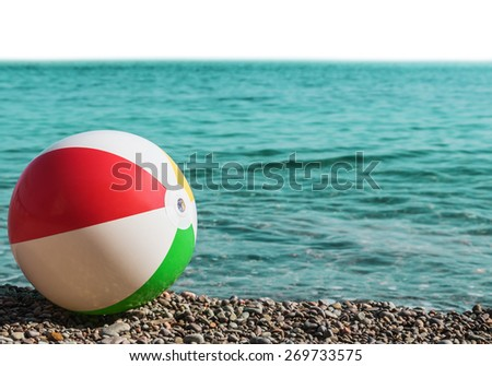 childrens ball on the beach isolated on white background. Focus on the ball