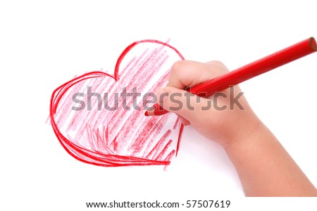 Childrens hand with pencil draws the heartl, isolated - stock photo