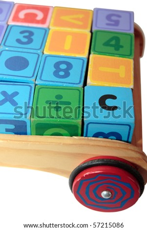 childrens toy letter building blocks all together in a toy cart isolated on white background - stock photo