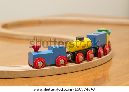 childrens toy train on track - stock photo
