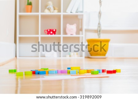 Childrens toy wood blocks inside a home - stock photo
