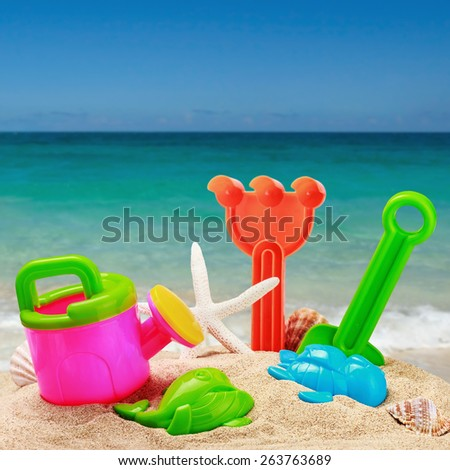 childrens toys in the sand on the beach. focus on toys - stock photo