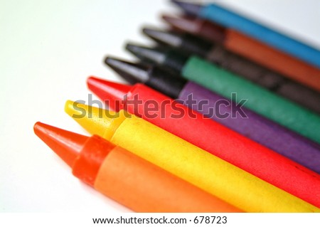 Childs colored crayons, arranged in a line. - stock photo