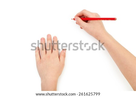 Childs hands drawing on a white paper - stock photo