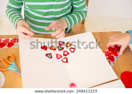 Childs, kids, engaged in a Valentine's Day arts and crafts activity