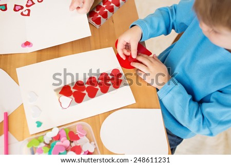 Childs, kids, engaged in a Valentine's Day arts and crafts activity - stock photo