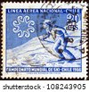 "CHILE - CIRCA 1965: A stamp printed in Chile from the ""World Skiing Championships - Chile 1966"" issue shows Skier crossing slope, circa 1965. - stock photo"
