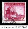 CHILE - CIRCA 1936: A stamp printed in Chile shows port crane and merchant ship, circa 1936 - stock photo