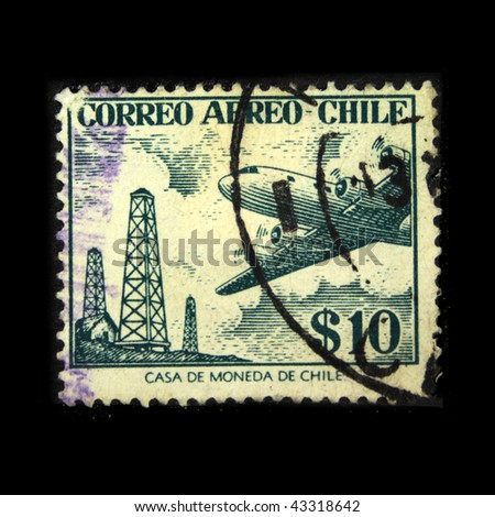CHILE - CIRCA 1950s: A stamp printed in Chile shows plane on the background of oil rigs, circa 1950s