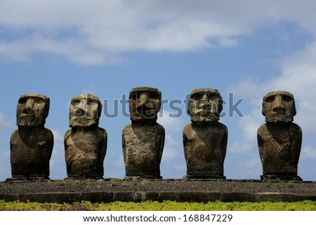 CHILE - FEBRUARY 6: Moai sit on Easter Island on February 6, 2012. The giant monuments were carved from volcanic stone and face away from the mythical spirit world of the sea.