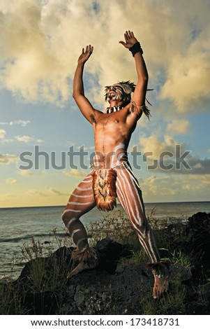 CHILE - FEBRUARY 5: Portrait of Easter Island male in traditional Rapa Nui warrior dress on February 5, 2012. - stock photo