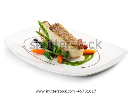 Chile Sea Bass (black sea bass) served with Black Risotto, Herbs and Vegetables - stock photo