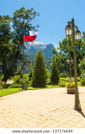 Chilean flag in a beautiful square with a lot of nature