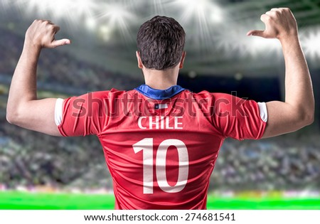 Chilean Soccer player in the stadium - stock photo