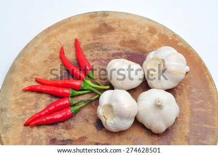Chili and garlic on the cutting board in a white background - stock photo