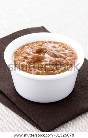 Chili beans with kidney beans and lean ground beef. Chili powder, tomato paste and other delicious ingredients, this great chili recipe can be seasoned to taste to create a mildly flavored dish. - stock photo
