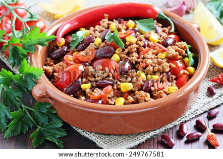 Chili con carne and fresh vegetables.Selective focus. - stock photo