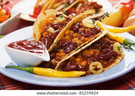 Chili con carne burritos in corn taco shells - stock photo
