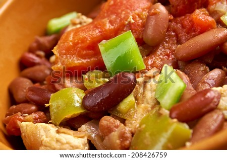 Chili con carne - in American English as simply chili, is a spicy stew containing chili peppers, meat (usually beef), tomatoes and often beans - stock photo