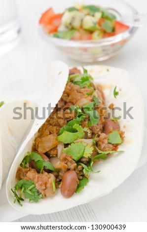 chili con carne in wheat tortillas vertical - stock photo