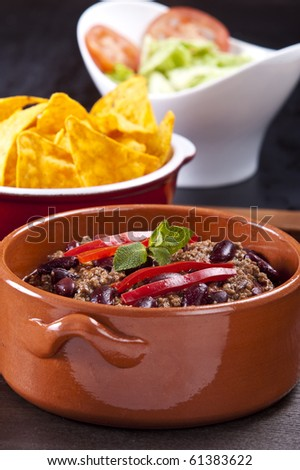 Chili con carne on white background with shadows - stock photo
